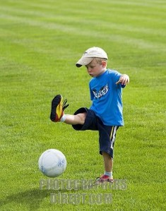 A four year old boy at soccer practice